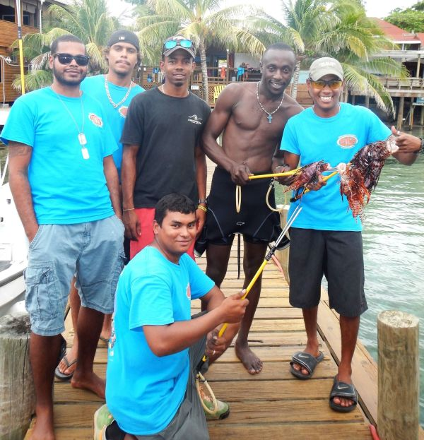 Ocean Connections staff after a quick lionfish hunt - photo from the Roatan Marine Park