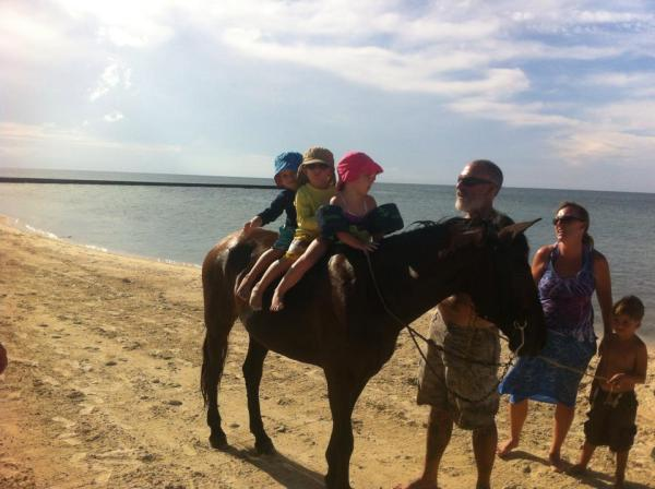 Spencer and friends bareback riding on the beach. Typical island day! (Swimmies for safety)