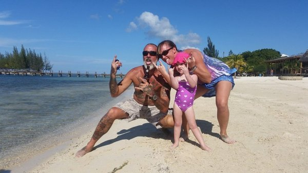 Brian, Kirsty, and Spencer Rose enjoying a typical beach day in Roatan, Honduras