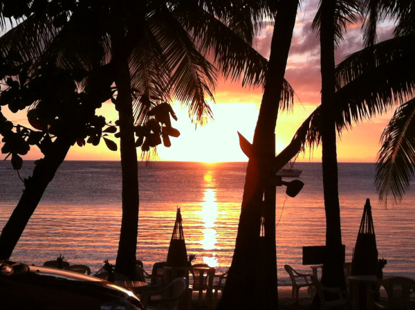 Sunset over Half Moon Bay, Roatan. Photo by Amanda Walkins